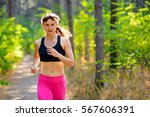 young woman running on the... | Shutterstock . vector #567606391
