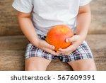 organic mango in hands on the... | Shutterstock . vector #567609391