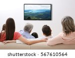 family watching television at... | Shutterstock . vector #567610564