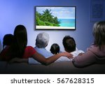 family watching television at...   Shutterstock . vector #567628315