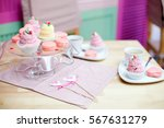 cakes in pastel colors in... | Shutterstock . vector #567631279