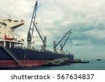 shipping unloading in the ocean.... | Shutterstock . vector #567634837