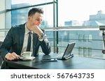 young businessman in suit... | Shutterstock . vector #567643735