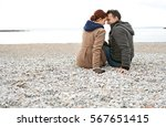 rear view of tourist couple...   Shutterstock . vector #567651415