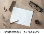 letters and dried flower in... | Shutterstock . vector #567661699