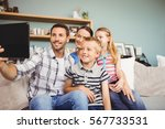happy family taking selfie from ... | Shutterstock . vector #567733531