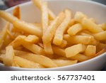 closeup of french fries  in a... | Shutterstock . vector #567737401