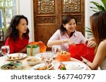 woman unwrapping gifts and... | Shutterstock . vector #567740797