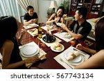adults sitting around dinner... | Shutterstock . vector #567743134