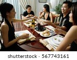 adults having dinner party | Shutterstock . vector #567743161