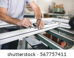 manual worker assembling pvc... | Shutterstock . vector #567757411