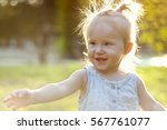 cheerful little girl in a... | Shutterstock . vector #567761077