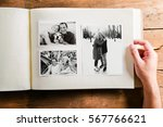 Small photo of Hand holding photo album with pictures of senior couple. Studio