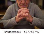 Unrecognizable Senior Man At...