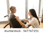 disabled senior woman in... | Shutterstock . vector #567767251