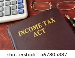 book with title the income tax... | Shutterstock . vector #567805387