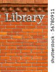 metal library sign on a brick wall background - stock photo