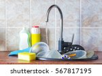 dirty dishes in the sink. | Shutterstock . vector #567817195