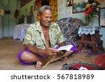indigenous fijian man reads the ... | Shutterstock . vector #567818989