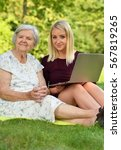 young woman helping an elderly... | Shutterstock . vector #567819265