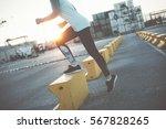 woman doing step up. urban... | Shutterstock . vector #567828265