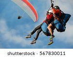 Two Paraglider Tandem Fly...