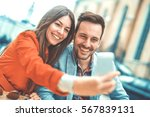 young couple taking a selfie... | Shutterstock . vector #567839131