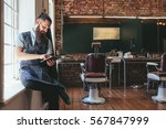 barber with digital tablet... | Shutterstock . vector #567847999