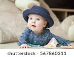 little baby girl in the big hat | Shutterstock . vector #567860311