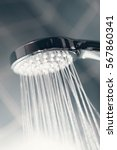 modern shower head splashing... | Shutterstock . vector #567860341
