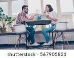 happy coworkers working... | Shutterstock . vector #567905821