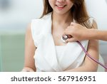 Doctor Using Stethoscope To...