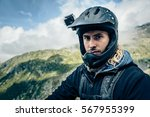 mountainbiker with actioncam on ... | Shutterstock . vector #567955399