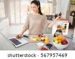 Woman Preparing Fruit Juice...
