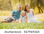 beautiful smiling family... | Shutterstock . vector #567969265