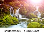 mountain stream among the mossy ... | Shutterstock . vector #568008325