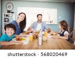 smiling family with food on... | Shutterstock . vector #568020469