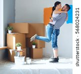 happy young couple moving in... | Shutterstock . vector #568024231