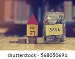 money house from the coins... | Shutterstock . vector #568050691