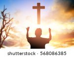 human raising hands. mercy... | Shutterstock . vector #568086385