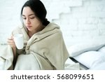 young woman sick in bed with... | Shutterstock . vector #568099651