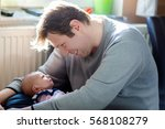 happy proud young father having ... | Shutterstock . vector #568108279