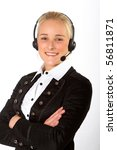 A young, attactive businesswoman wearing headphones - stock photo