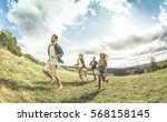 group of friends running free... | Shutterstock . vector #568158145
