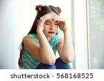 sad teenage girl sitting near...   Shutterstock . vector #568168525
