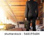 businessman holding a briefcase ...   Shutterstock . vector #568195684