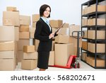 young woman with clipboard in... | Shutterstock . vector #568202671