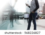 man holding the phone with... | Shutterstock . vector #568226827