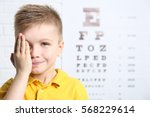 little boy having eye test at... | Shutterstock . vector #568229614