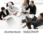 team of doctors working in... | Shutterstock . vector #568229659